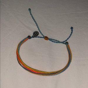 Dark blue, light blue, yellow, and orange bracelet